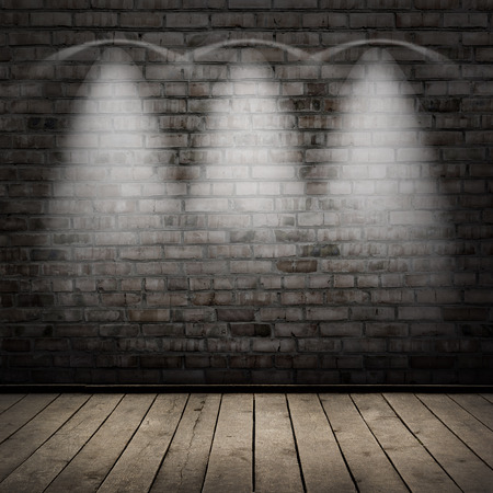 dark room: Dark room, wood floor and brick wall  with spot lights background Stock Photo