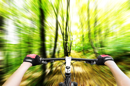 Mountain biking down hill descending fast  View from bikers eyes  Motion blurred