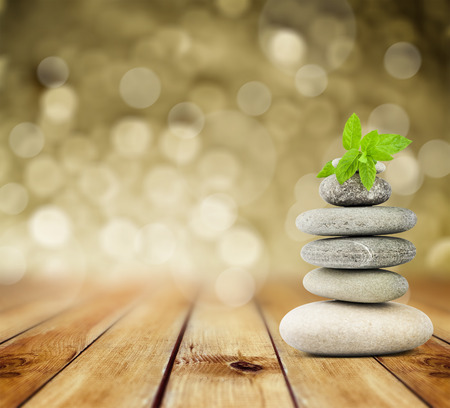 spa: zen stones on the old wooden background Stock Photo