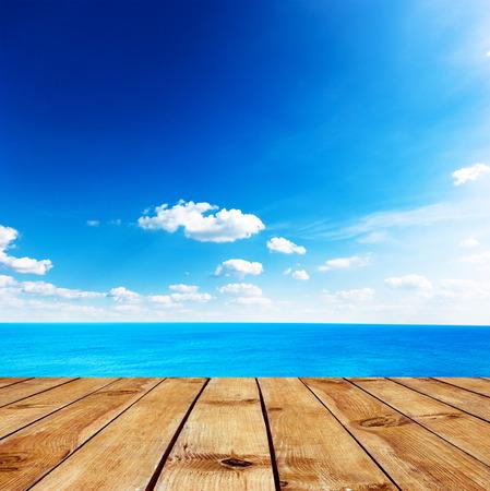sea dock: Beauty seascape under blue clouds sky. View from pier