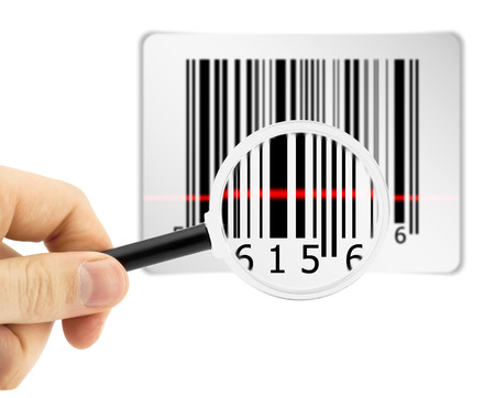 Barcode with scanner laser by magnifier glass in hand photo