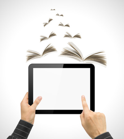 Black tablet pc like ipade in hands and book on white background. Portable computer education concept photo