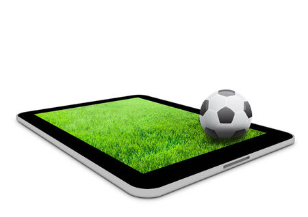 Black tablet computer with field and soccer ball photo