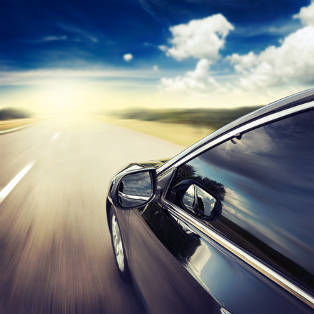 Blurred road and car, speed motion background photo