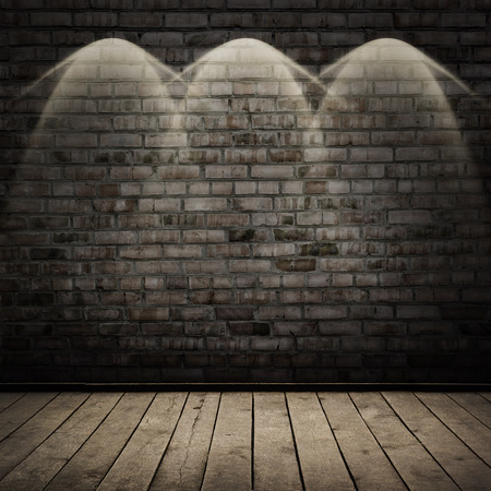 dark room: Dark room with wood floor and brick wall background Stock Photo