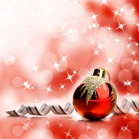 christmas bulbs: Red christmas toy over abstract bright yellow background Stock Photo