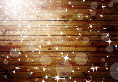 shiny floor: The brown wood texture with natural patterns and flying stars. Christmas concept background Stock Photo