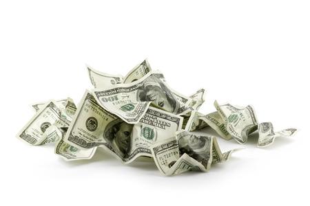Haufen von zerknüllten Geld-Dollar-Scheine overs weißen Hintergrund Standard-Bild