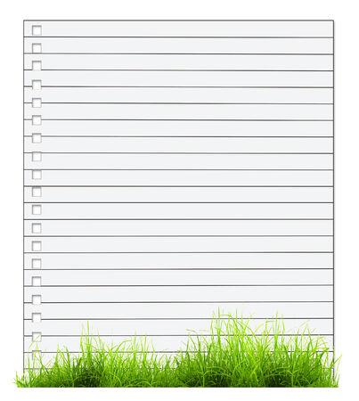 one sheet: Un foglio di quaderno con erba verde isolato su sfondo bianco