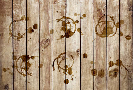 cruddy: Coffee stains on a grunge old wooden background Stock Photo