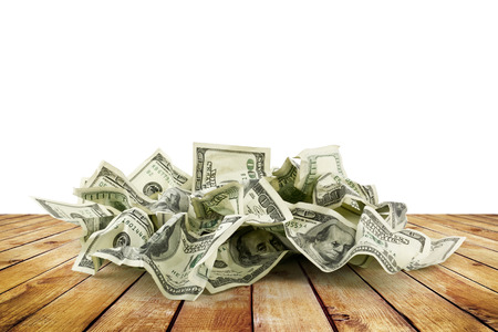 overs: Pile of crumpled money dollar bills on wood planks overs white background Stock Photo