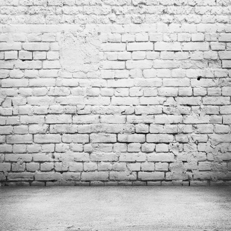 タイルの床とレンガの白い壁バック グラウンドあかるい