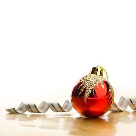 Red christmas toy over white background photo