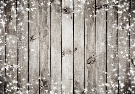 wooden panel: the brown wood texture with white snow and stars. Christmas background