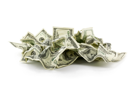 Pile of crumpled money dollar bills overs white background photo