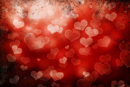 black grunge background: Valentine day background with hearts on black