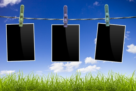 blue sky background: Photo frames pictures on blue sky and grass background