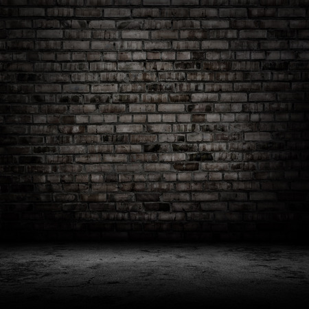 black grunge background: Dark room with tile floor and brick wall background