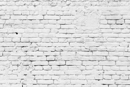 Old grunge brick white wall background