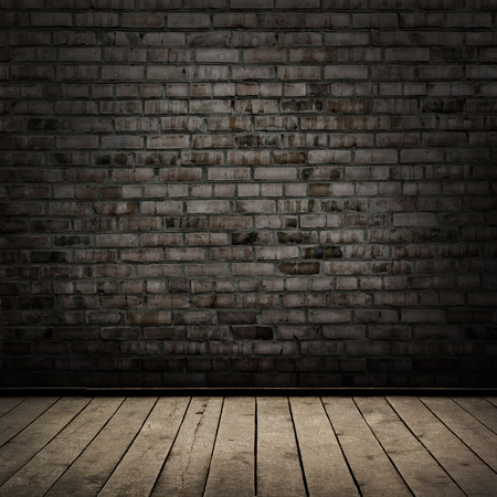 abandon: Dark room with wood floor and brick wall background Stock Photo