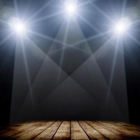 spotlight: ilustration of concert spot lighting over dark background and wood floor