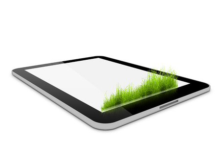 one computer tablet like ipade with grass on it over white background (render) photo