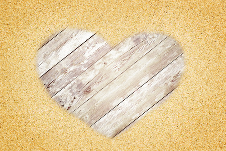 heart in sand: Heart shape with sand over wood background. Valentines concept