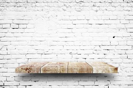 white shelf: Wooden shelf white brick background