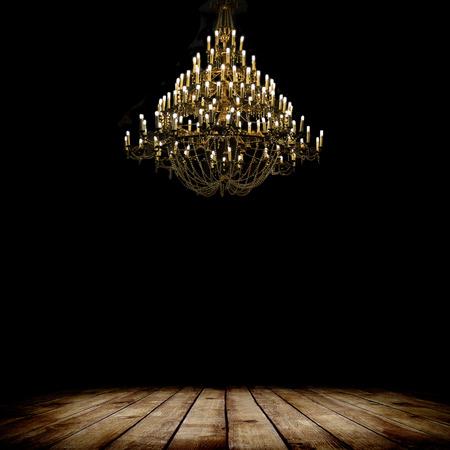 vintage chandelier: Image of grunge dark room interior with wood floor and chandelier. Background