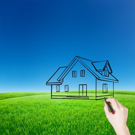House sketch hand draw over blue sky with green field photo