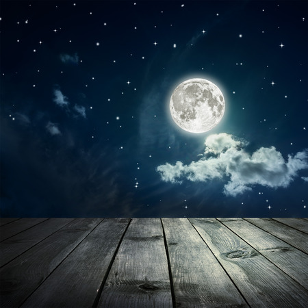 night table: Night sky with stars and full moon, wooden planks.  Stock Photo