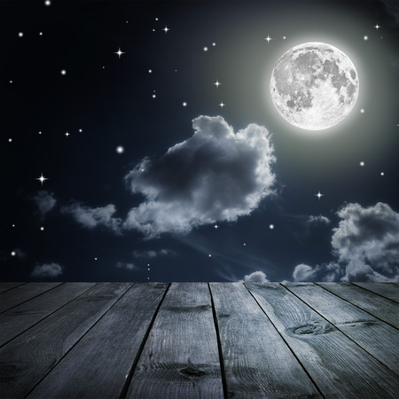 Night sky with stars and full moon, wooden planks. Elements of this image furnished by NASA