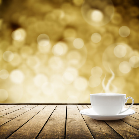 christmas tea: Cup with hot drink on wood table over abstract bokeh  background Stock Photo