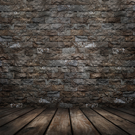 Dark room with wood floor and brick wall background Stock Photo