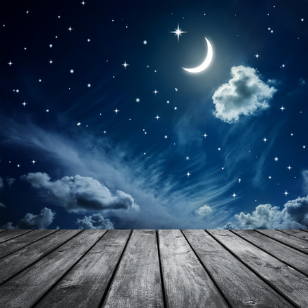 Night sky with stars and moon, wooden planks