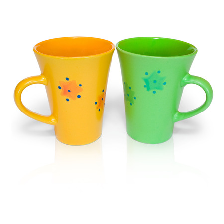 stimulant: two colored cups isolated on white