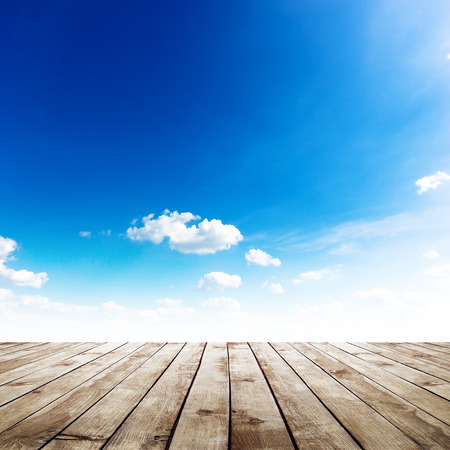 wood planks: blue sky with clouds and wood planks floor background
