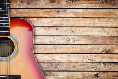 bluegrass: Guitar against a rustic wood background