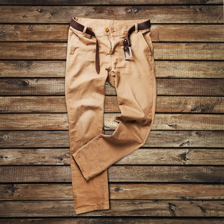 trouser: Jeans trouser over white wood planks background
