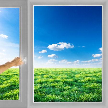 Hand open window field nature background Stock Photo
