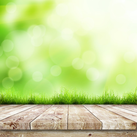 wood grass: Fresh spring green grass with green bokeh and sunlight and wood floor. Beauty natural background