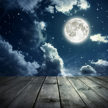 over the moon: Night sky with stars and full moon, wooden planks.