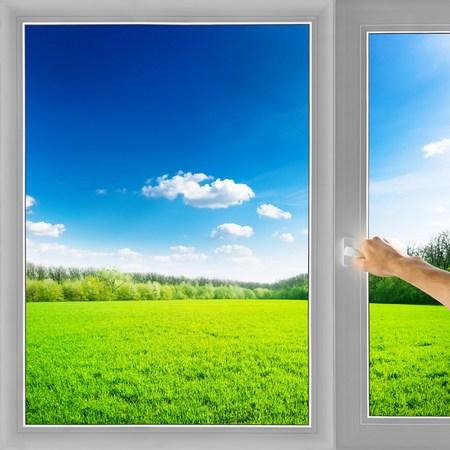 Hand open window field nature background Archivio Fotografico