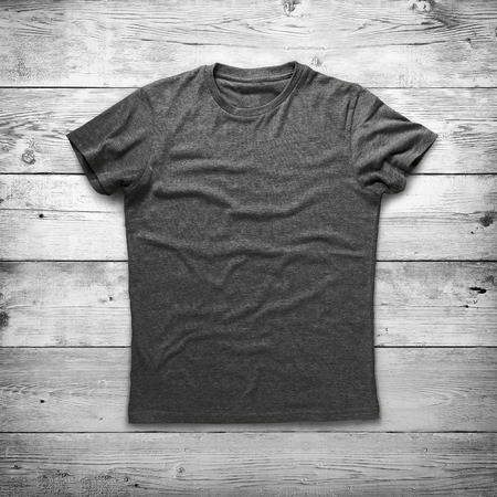 isolated on grey: Grey shirt over wood background