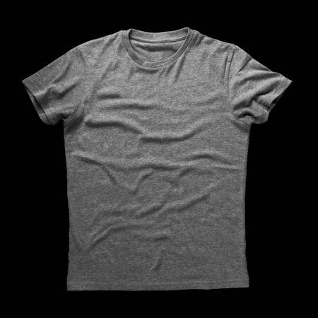black t shirt: Grey shirt isolated on black background