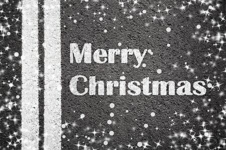 highway: Asphalt texture background with white line and text Merry Christmas Stock Photo