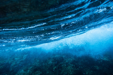 water wave: Sea bottom with blue water wave splash background