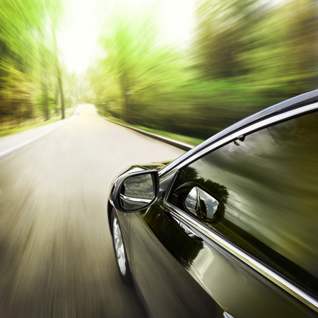 light speed: Blurred road and car, speed motion background