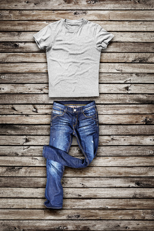 trouser: BLue jeans trouser and shirt over wood background