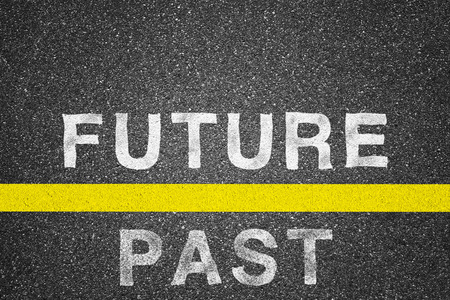 Future and past words over asphalt texture background Stock Photo